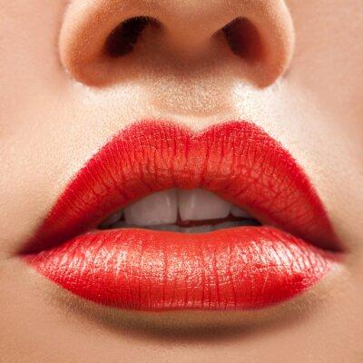 Plakat Macro photo of beautiful woman lips with red lipstick