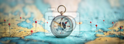 Plakat Magnetic compass  and location marking with a pin on routes on world map. Adventure, discovery, navigation, communication, logistics, geography, transport and travel theme concept background..