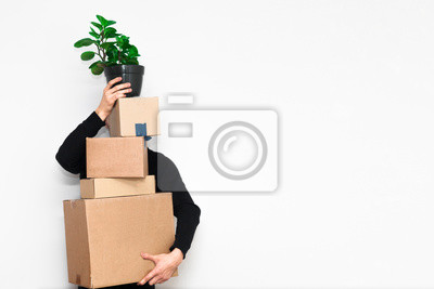 Plakat Man with box moving in a new apartament. Moving concept.
