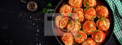 Meatballs in sweet and sour tomato sauce. Top view, banner