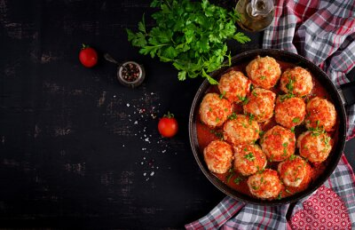 Meatballs in sweet and sour tomato sauce. Top view, overhead