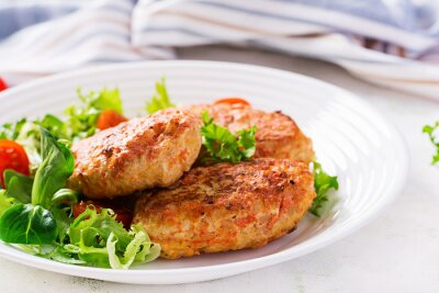 Meatballs with cabbage. Lazy cabbage rolls with fresh salad on light background. Russian cuisine.