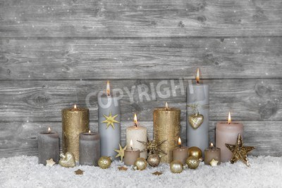 Plakat Merry christmas greeting card: wooden grey shabby background with candles.