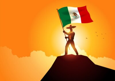 Plakat Mexican man in sombrero and traditional costume holding the flag of Mexico on mountain peak