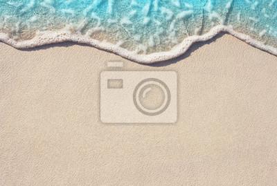 Plakat Miękkie fal oceanicznych na piaszczystej plaży, tło.