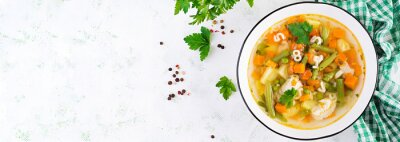Minestrone, italian vegetable soup with pasta on light table. Top view, banner, copy space
