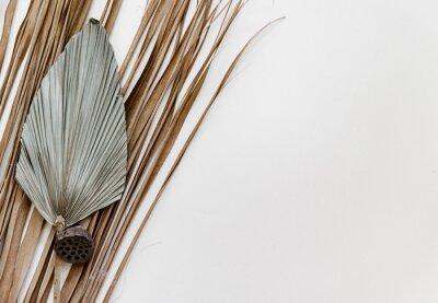 Plakat Minimal Summer stationery still life scene. Dry palm leaf on neutral background.
