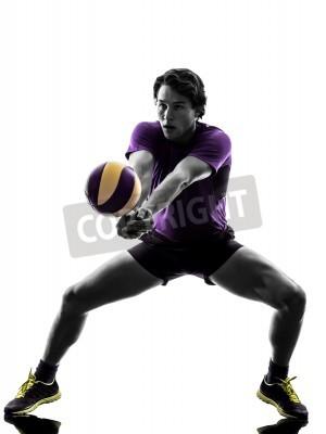 Plakat Młody gracz siatkówki jest w sylwetka białym tle