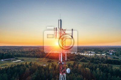 Plakat Mobile communication tower during sunset from above.