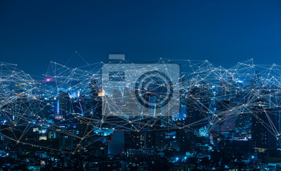 Plakat Modern city with wireless network connection and city scape concept.Wireless network and Connection technology concept with city background at night.