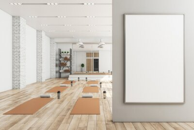 Plakat Modern concrete yoga gym interior with equipment, blank banner on wall, daylight and wooden flooring. Healthy lifestyle concept. Mock up, 3D Rendering.