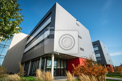 Plakat modern office building against a nice blue sky