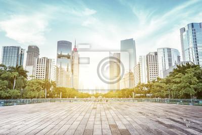 Plakat modern square and skyscrapers under sunbeam