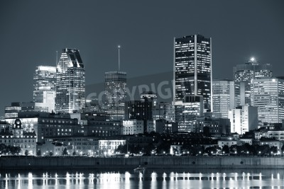 Plakat Montreal over river at dusk with city lights and urban buildings in black and white