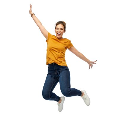 Plakat motion, freedom and people concept - happy young woman or teenage girl jumping over white background