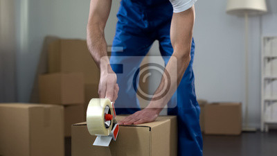 Plakat Moving company worker packing cardboard boxes, quality delivery services