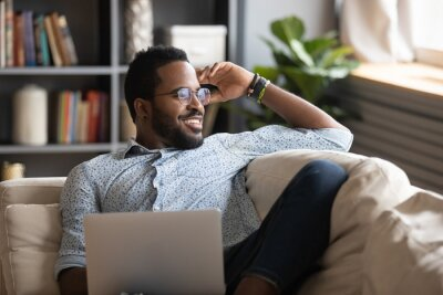 Plakat Multiracial freelance guy distracted from job study, looking at window.