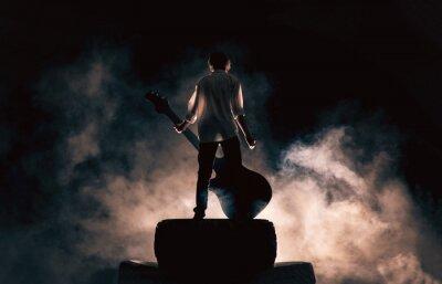 Plakat Muzyk rockowy i duża gitara, dużo dymu
