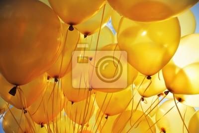 Plakat Nadmuchiwane balony helem żółte tło strony