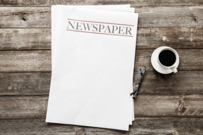 Plakat Newspaper and coffee on wooden background