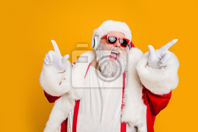 Plakat Nightclub invite on christmas party celebration funky crazy santa claus dj in white headset sing song sound melody listen music dance wear stylish x-mas hat suspenders isolated yellow color background