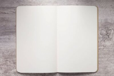 Plakat Notebook paper at stone  surface table, top view