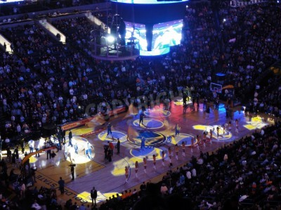 Plakat OAKLAND, CA - FEBRUARY 22: Celtics vs. Warriors: Start of game light show goes on as cheerleaders pump up fans  at Oracle Arena taken February 22, 2011 Oakland California.