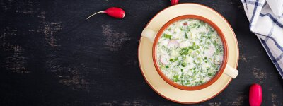 Okroshka. Cold summer soup with yogurt and vegetables in bowl. Top view, overhead, banner