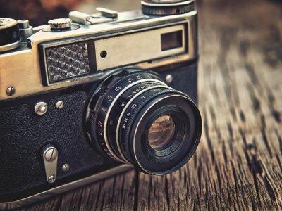 Plakat old vintage camera closeup on wooden background