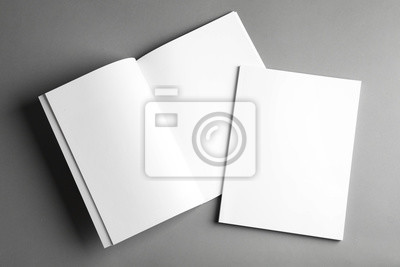 Plakat Open and closed blank brochures on grey background, top view. Mock up for design