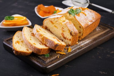 Orange cake with dried apricots and powdered sugar.