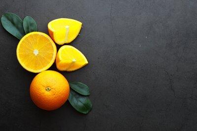 Plakat Orange citrus fruit on a stone table. Orange background.