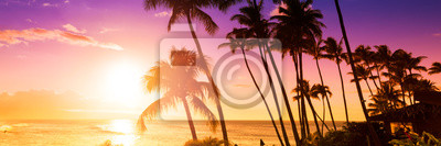 Plakat Palm tree silhouette on a background of tropical sunset