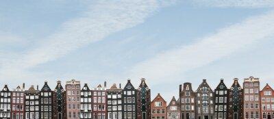 Plakat Panorama lub widok panoramiczny. Tradycyjni domy w Amsterdam w holandiach z rzędu przeciw niebieskiemu niebu.