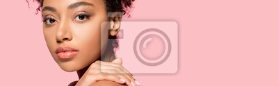 Plakat panoramic shot of beautiful african american girl with clean face, isolated on pink