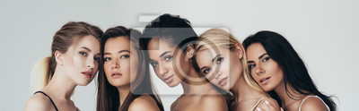 Plakat panoramic shot of five multiethnic girls looking at camera isolated on grey