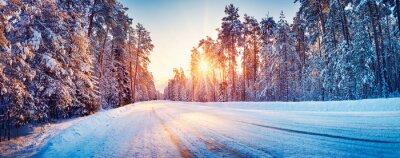 Plakat Panoramic view of the beautiful rural road in winter