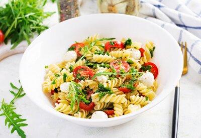 Pasta salad. Fusilli Pasta - Caprese salad with tomato, mozzarella and basil.