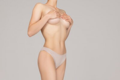 Plakat Perfect slim toned young body of the girl or fit woman at studio. The fitness, diet, sports, plastic surgery