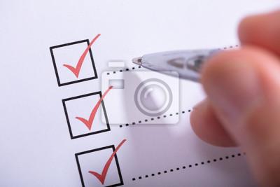 Plakat Person's Hand Marking On Checklist