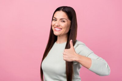Plakat Photo of attractive lovely young woman show hand thumb-up recommend smile isolated on pink color background