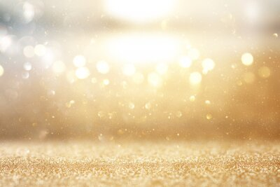 Plakat photo of gold and silver glitter lights background