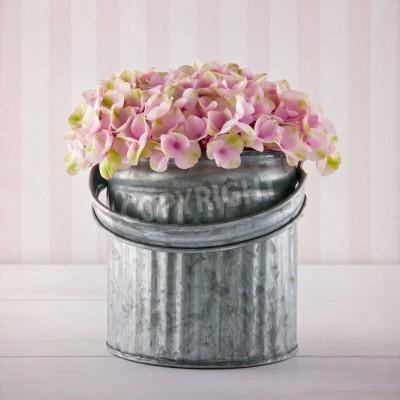Plakat Pink hydrangea flowers in a metal bucket on vintage striped background