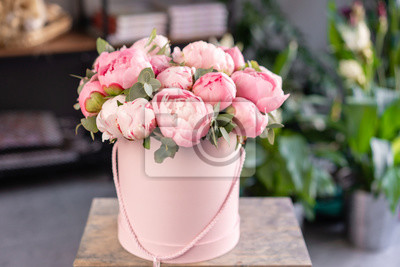 Plakat Pink peonies on the old grey table. Beautiful peony flower for catalog or online store. Floral shop concept . Beautiful fresh cut bouquet. Flowers delivery