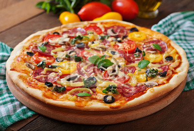 Pizza with salami, tomato, cheese and olives