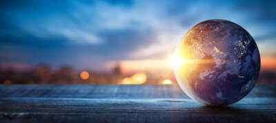 Plakat Planet earth on the background of blurred lights of the city. Concept on business, politics, ecology and media.  Elements of this image furnished by NASA
