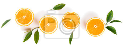 Plakat Pół cięte pomarańcze i zielone liście.