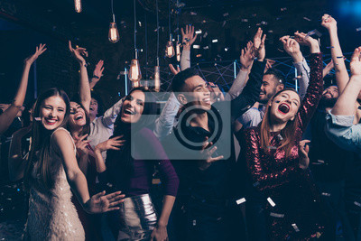 Plakat Portrait cute attractive lovely youth millennial person laugh excited funny funky motion having fun free time raise fists fromal wear suit dress fashionable modern magnificent indoors dance floor