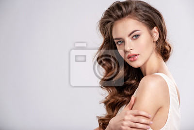 Plakat Portrait of a young beautiful woman with a long hair.