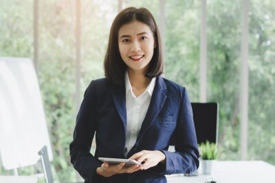 Plakat portrait of asian business woman in company meeting room.